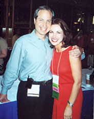 Lisa Kleypas in a red dress standing with her agent Mel Berger